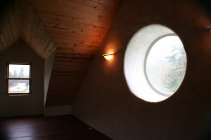 round window in a straw bale house