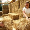 Woman building a straw bale house