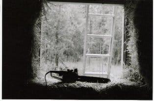 chainsaw in straw bale house window