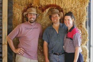 Andrew Morrison and Friends in Front of a Straw Bale Wall