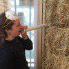 woman talking through a straw bale
