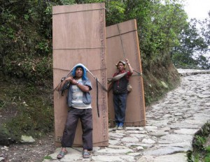 two men carrying plywood