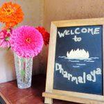 Dharmalaya center welcome sign