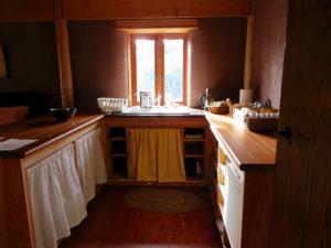 straw bale cabin kitchen