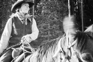 woman riding on horseback
