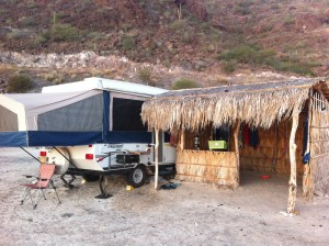 pop up tent trailer by a palapa