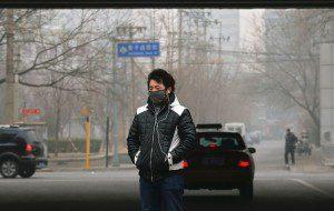 man walking through pollution