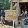 People Stacking Straw Bale Walls on Edge
