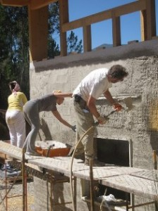 Andrew Morrison and friends applying plaster to straw bale walls
