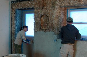 plastering straw bale house
