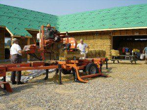 Portable saw mill cutting straw bales