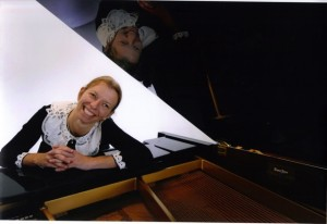 woman and grand piano