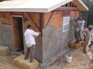 plaster application on straw bale house
