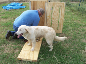 man building hand baler