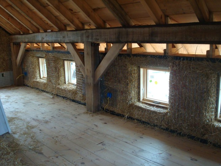 exposed interior timber frame in straw bale houses