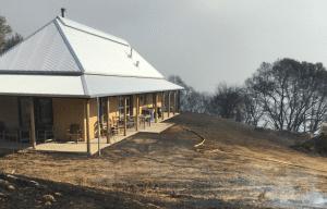 Wildland fires almost burns straw bale house