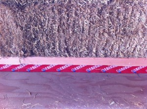 Moisture seal tape on a straw bale wall
