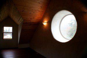straw bale wall with round window