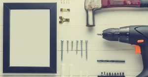 Tools for hanging pictures on a plaster wall