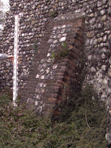 old stone buttress wall