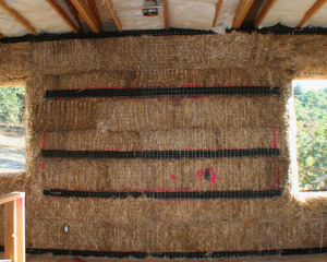 cabinet backing on straw bale wall
