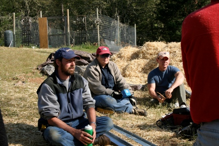 people sitting around straw bales