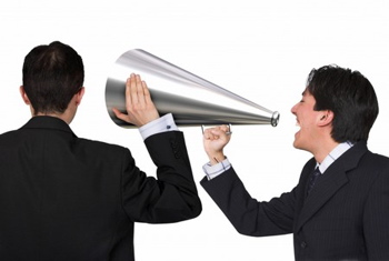 men speaking into megaphone