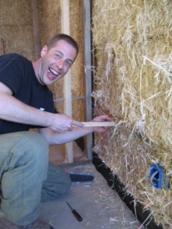 electrical subcontractor on straw bale wall