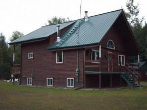 Wood sided straw bale house for sale