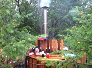 woman in wood fired hot tub
