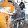 Mortar Mixer delivering plaster to wheel barrow