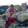 kids on straw bales