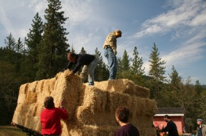 straw bales being unloaded