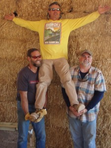men standing by straw bale wall