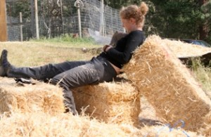 Woman sitting on straw bales