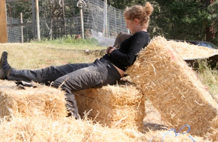 woman sitting on straw bales