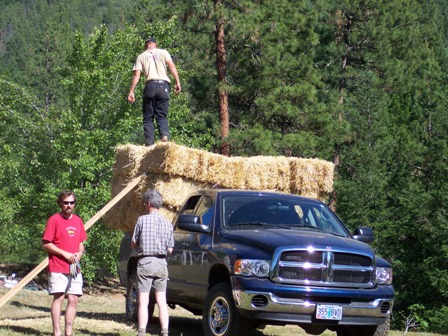 unloading straw bales
